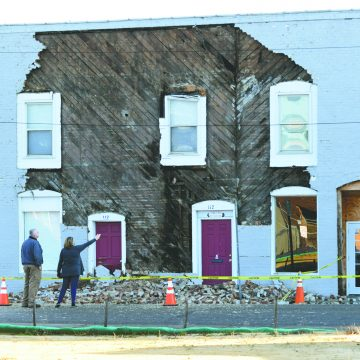Century-old building loses veneer, will be repaired