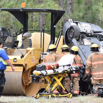 Driver killed when car hits construction machine