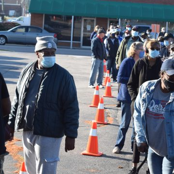 Early voting begins with lines clear to the post office